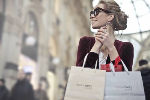 Photo of a Woman Holding Shopping Bags #328425