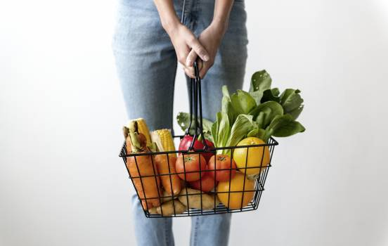 Woman Carrying Basket of Fruits and Vegetables #328520