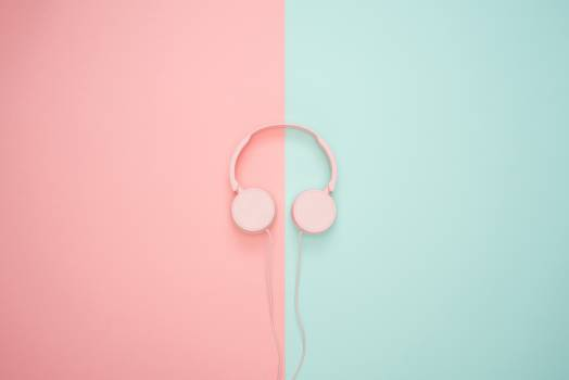Pink Corded Headphones on pink and teal Wall Free Photo
