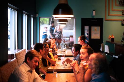 People Surrounding Brown Wooden Rectangular Table While Seating Free Photo
