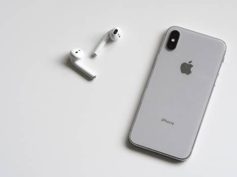 Silver Iphone X With Airpods Free Photo