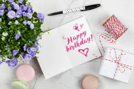 Happy Birthday Card Beside Flower, Thread, Box, and Macaroons Free Photo