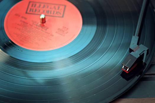 Black Vinyl Record Playing on Turntable Free Photo
