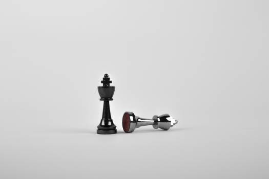 Two Silver Chess Pieces on White Surface Free Photo