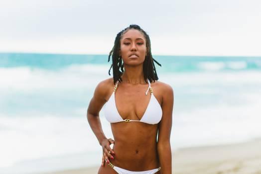 Woman Wearing Bikini Standing in Front of Body of Water #328852