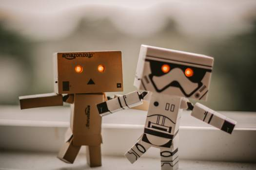 Selective Focus Photography of Two Danbo and Star Wars Stormtrooper Robot Toys Free Photo