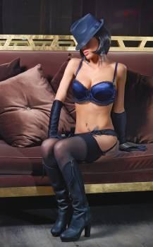 Woman in Blue Bikini Sitting Brown Sofa #32923