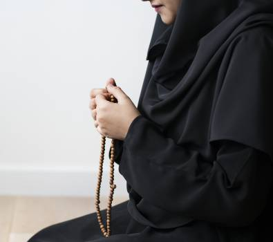 Woman Holding Prayer Beads Free Photo