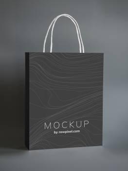 Black Shopping Bag Mockup Design on Gray Surface Free Photo