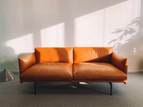 2-seat Orange Leather Sofa Beside Wall #329516