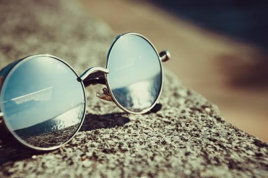 Silver Framed Hippie Sunglasses on Concrete #329696