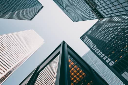 Five Gray Concrete Buildings Under Blue Sky Free Photo