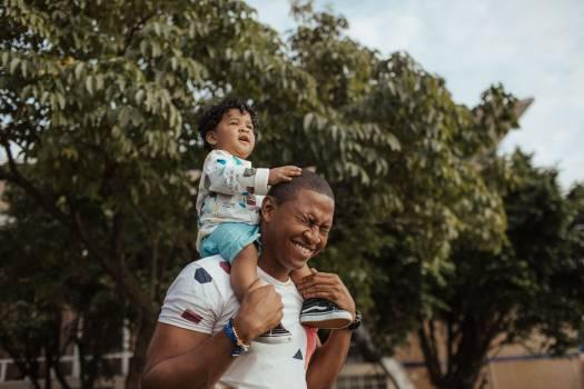 Man Carrying Child Free Photo