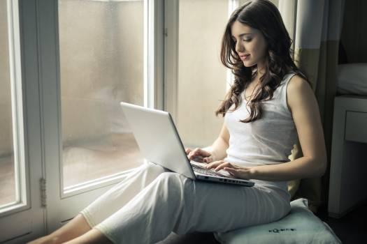 Woman Wearing Tank Top Sitting by the Window #330011