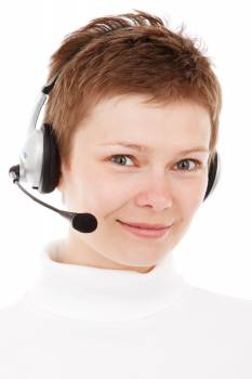 Person Wearing Silver Headset Smiling Free Photo
