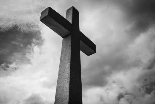 Low Angle Photo of Concrete Cross Under Clouds Free Photo