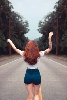 Photo of Woman Raising Her Hands #330218