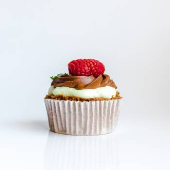 Photograph of Chocolate Cupcake With Red Strawberry Toppings Free Photo
