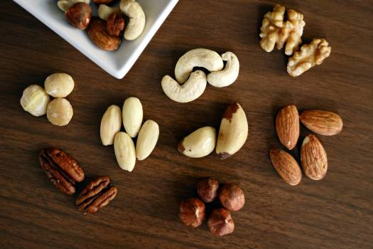 Variety of Brown Nuts on Brown Wooden Panel High-angle Photo #330472