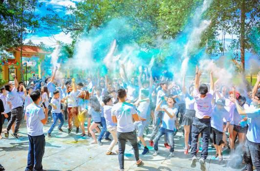 People Throwing Blue Powder at Daytime Free Photo