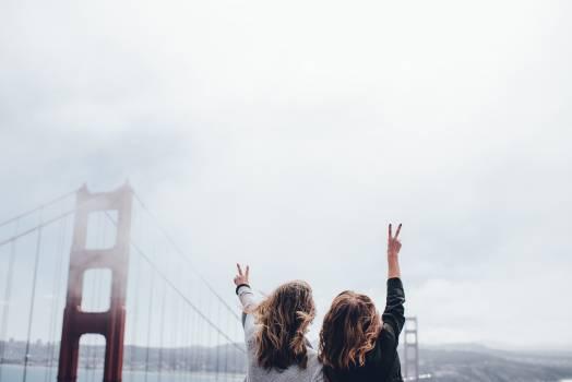 Bridge suspension bridge golden gate bridge women Free Photo