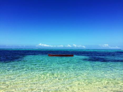 Boat in the Middle of Atoll Photo #33176