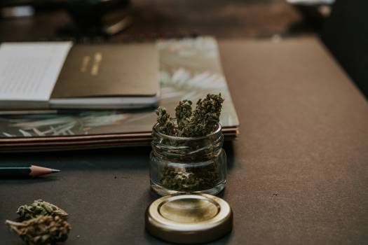 Close-Up Photo of Kush On Glass Container #331814