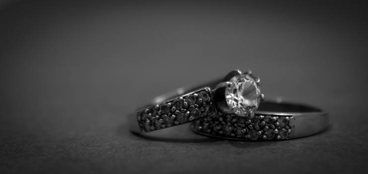 Grayscale Photo of 2 Silver With Diamond Rings #33196