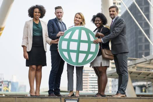 Five People Standing While Holding Green Globe Art Free Photo