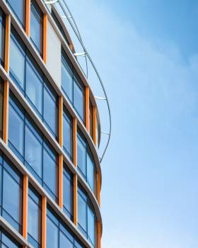 Low Angle Photography of Orange and White Glass-curtain Building Free Photo