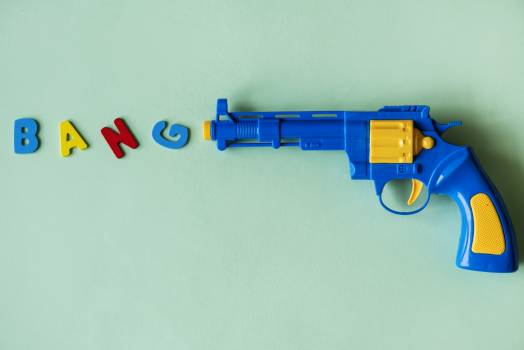 Blue and Yellow Plastic Toy Revolver Pistol Free Photo