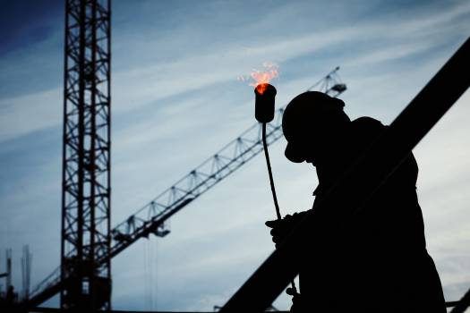 Silhouette of Man Holding Flamethrower Free Photo