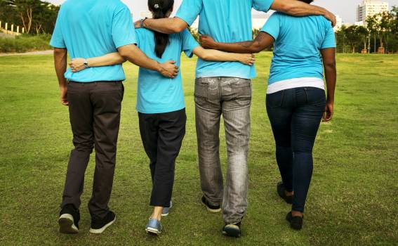 Four People Walking While Holding Each Others Arms #332321