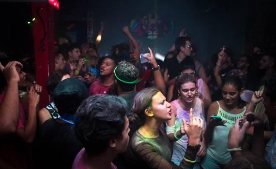 Crowd Dances in Blue Painted Enclosure Free Photo