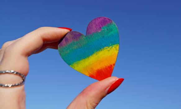 Person Holding Multicolored Heart Decor Free Photo