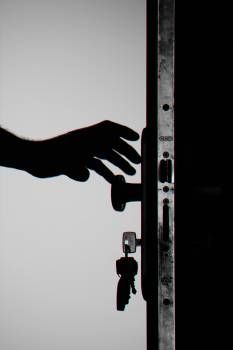 Silhouette Photo of Person Holding Door Knob Free Photo