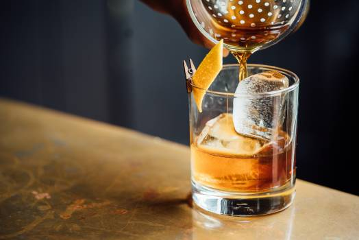 Brown Liquid Pouring on Clear Shot Glass #33263