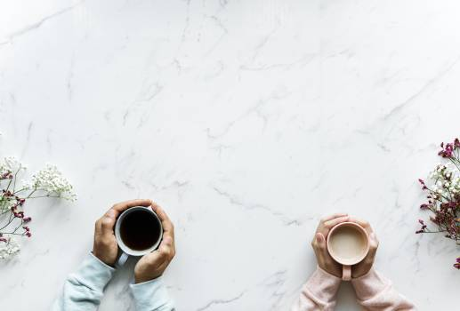 Person Holding Mug on Table Free Photo