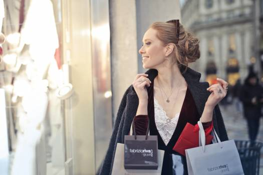 Woman Wearing Black Blazer Holding Shopping Bags Free Photo