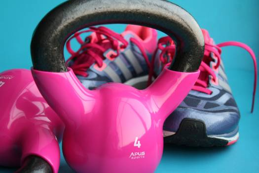 Kettle Bell Beside Adidas Pair of Shoes #332804