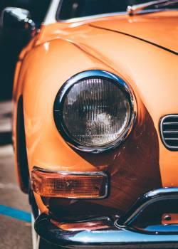 Close-Up Photography of Orange Vintage Car Free Photo
