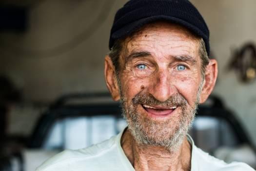 Smiling Man With Black Cap Free Photo