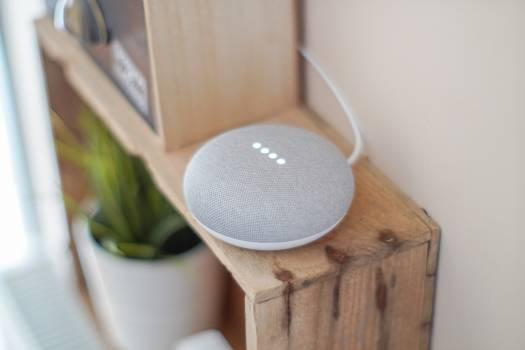 Round Grey Speaker On Brown Board Free Photo