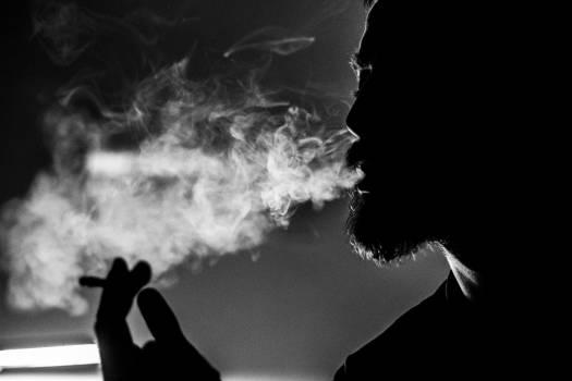 Man Holding Cigarette Free Photo