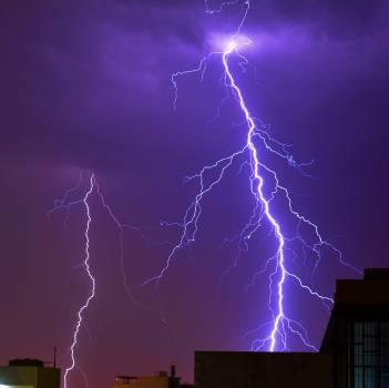 Thunder Striking a Building Photo Free Photo