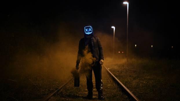 Man Wearing Black Jacket Standing On Railroad #334096