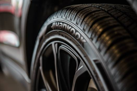 Close-up Photography of Vehicle Wheel and Hankook Tire Free Photo