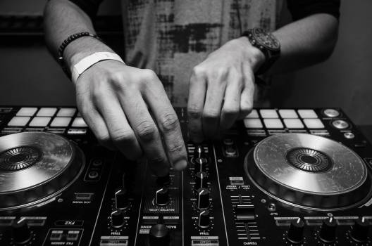Grayscale Photography of Person Using Dj Controller Free Photo