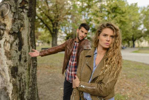 Woman And Man Wearing Brown Jackets Standing Near Tree Free Photo
