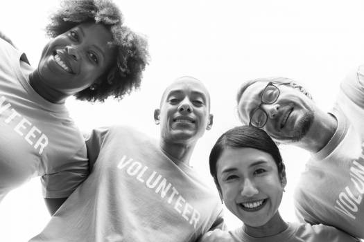 Grayscale Photography of Group of People Wearing Volunteer-printed Shirt Free Photo